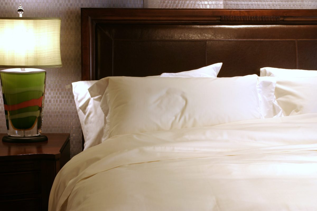 Bespoke Hotel Linens in Ivory Herringbone jacquard with White Percale Cuff and flanges